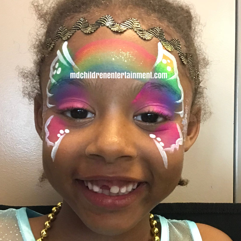 Rainbow face painting by Tanya! Hire me for parties in Toronto, Markham, Richmond Hill and surrounding areas!
