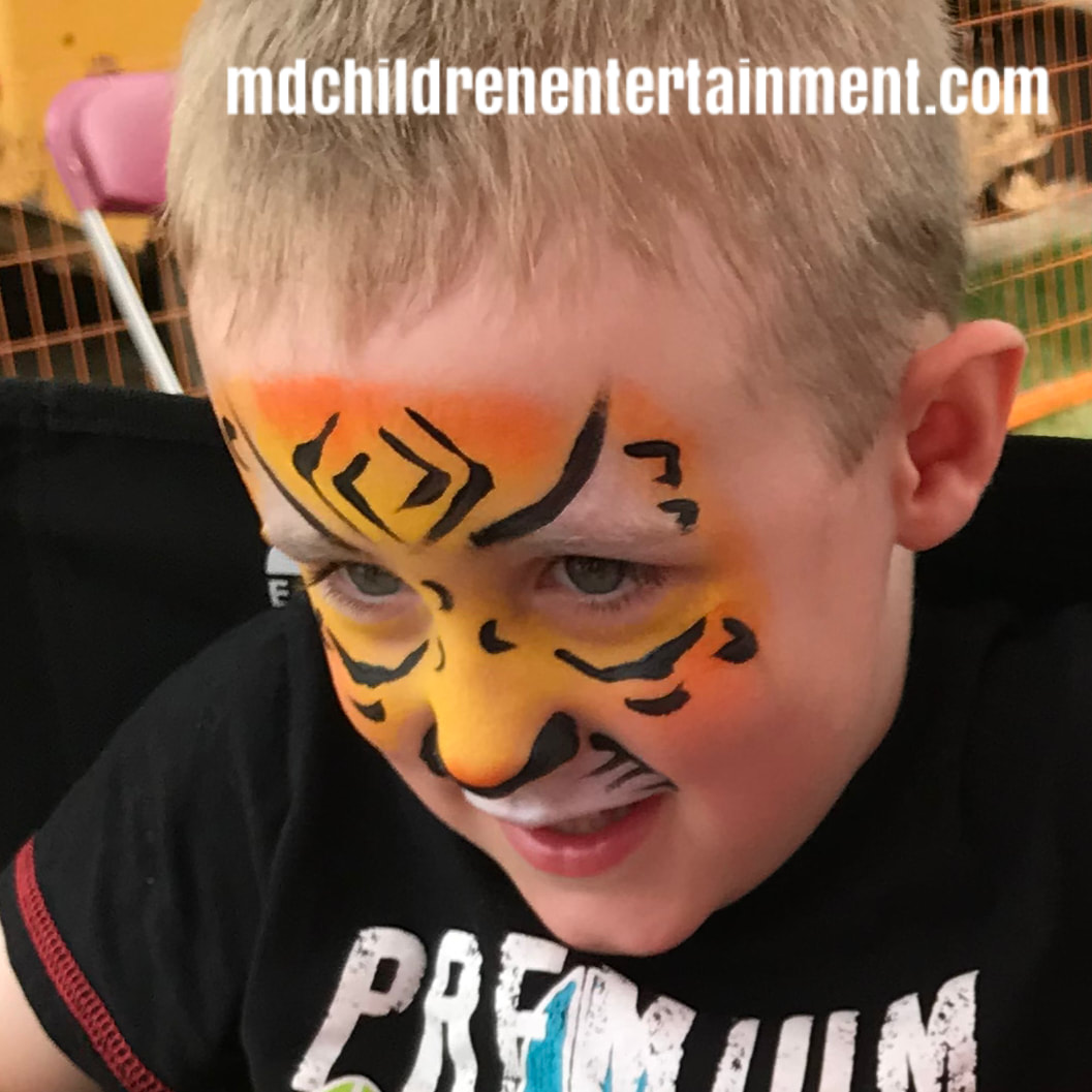 Face painted tiger! Hire us for face painting in services in Newmarket!
