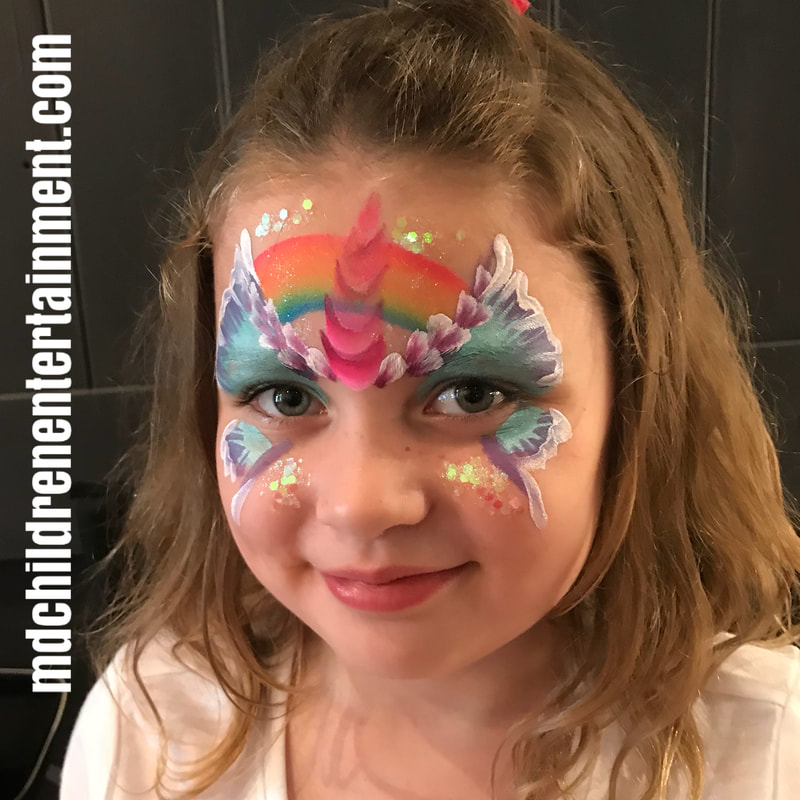 Butterfly unicorn and rainbow face painting!