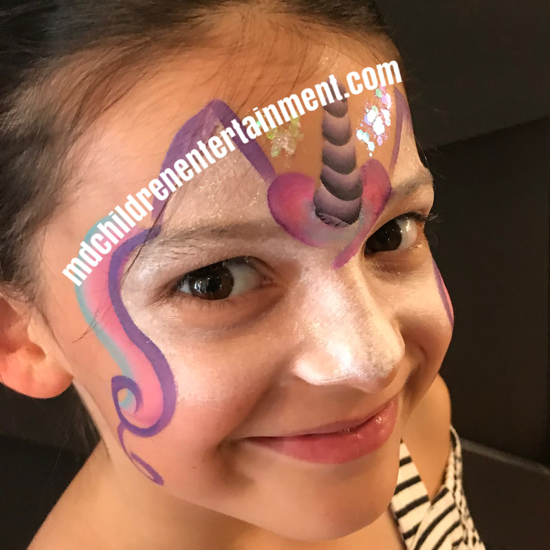 Unicorn quick face painting by Face Painter Tanya
